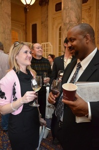 JJB's Nathalie Tremblay and Roland Hankerson exchange notes on 2010