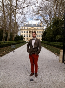JJ Buckley's (very dapper) Geoffrey Binder poses in front of Chateau Margaux